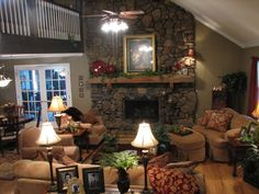 great room with stone fireplace, vaulted ceiling, loft and neutral furniture - lovely