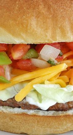 The taco burger is flavored with taco seasonings & layered with your favorite taco toppings like shredded cheese, tomatoes, onions, and jalapeños. Turkey Burger Recipes, Sandwich Recipes, Taco Burger, Taco Bar, Healthy Toddler Meals, Toddler Food, Burger Bar Party, Catering Food Displays, Great Recipes