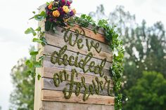 """Summer Harvest Farm to table rustic wedding inspiration - hand made wood palette back drop with custom moss lettering """"We've decided on forever"""""""