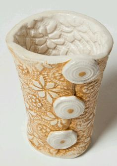 Pottery with Purpose, Terrice Bassler--------------almost looks like it is buttoned up (lol)
