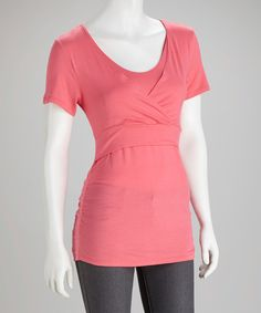 Made with Mom in mind, this top boasts a flattering surplice neckline and discreet overlap styling for convenient nursing in any setting. A sleek fabric with a hint of stretch and a bright, seasonal hue make it a must-have. 95% rayon / 5% spandexMachine wash; tumble dry