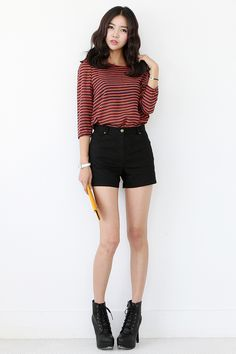 Striped shirt paired with simple black shorts and a pair of boots/sandals