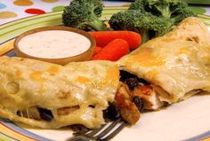 Chicken and Black Bean Enchiladas with Gooey Jack Cheese recipe from Robin Miller via Food Network