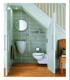 under stairs cloakroom love the full tiled wall facing good idea with the little shelf