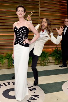 Jared Leto photobombing Anne Hathaway (in Viktor & Rolf) at the Vanity Fair Oscars After Party
