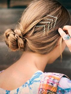 Free People blogger We love a good lazy-girl hairstyle—and this one takes all of 30 seconds. Pull your hair into a low, messy bun (a.k.a. the lazy-girl staple) and secure it at the nape of your neck. To create the chevron pattern, slide a bobby pin in on an angle, then slide a second pin through the end of the first one in the opposite direction. Repeat that three or four more times, about a half an inch apart—and voilà, you're out the door.