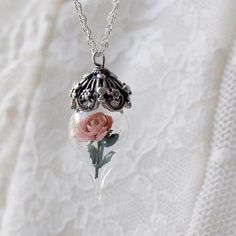 Pretty tiny rose necklace. Reminds me of Beauty & the Beast