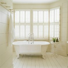 Again, very pretty, but needs some colour to it...  Classic white bathroom  Shutters from The New England Shutter Company provide a serene filtered light and add a subtle French feel to this ensuite bathroom, enhanced by the neutral colour scheme, painted floorboards and antique iron table. A similar roll-top bath can be found at Drummonds Architectural Antiques.  Chosen by Homes & Gardens