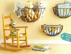 These wall hanging basket planters are shown holding toys in a childs room but they could be used in so many other ways.  In the bathroom they could hold a hair dryer or extra rolled up towels.  In a family room maybe remotes and the TV Guide.  In the utility room maybe laundry supplies.