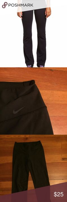 Nike Dri-Fit Yoga Pants Size M Only worn a few times. Dark grey/black color. Same cut as the first photo but note that the Nike swoosh is grey on these. Please ask questions if interested! Nike Pants Leggings
