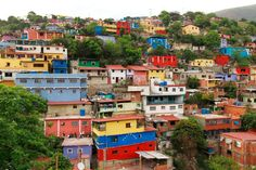 The Venezuelan capital Caracas boasts colorful neighborhoods too. Here, El. Spanish Pictures, Living In Brazil, International Day, Slums, Capital City, House Colors, Places To Travel, Party, The Neighbourhood