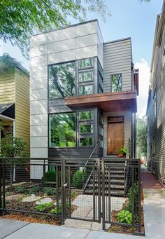 I like the fence and materials used in this Chicago home