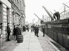 building The Wall brick by brick (onlookers are in West Berlin), August 1961