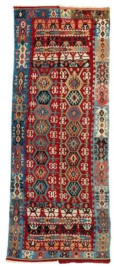 Woven in two panels, this red-ground kilim may be attributed, like OS-101, to the Hotamis Turkomans from the region south of Karapinar Turkey