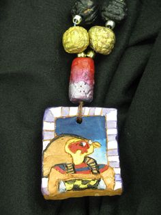 "4th grade ancient Egyptian style ceramic necklace with terra cotta beads; pendant approx. 2"" X 3""; lesson by art teacher: Susan Joe"