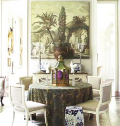 """Grisaille wallpaper panel, tole urn and garden seat, all antiques. Tablecloth in vintage Fortuny fabric."" Renovation, interior design and landscape design by Furlow Gatewood.Veranda May June 2011"