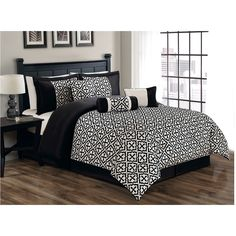 A chic black and ivory medallion pattern incorporates modern and traditional styling to create the unique Gladstone flocking comforter set. Crafted with machine washable microfiber, this printed bedding comes with shams, a skirt and decorative pillows.