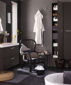 A comfy STORSELE chair in a stylish GODMORGON bathroom means you're always prepared for a few minutes of me-time.