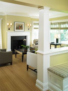 Sherwin Williams Ramie SW6156 (yellowish-green hue)  is beautiful when paired with white trim. l Coastal Living Rooms l www.DreamBuildersOBX.com
