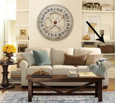 Living Room, Pottery Barn Living Room Nuanced By Cool Details: Lovely Barn Living Room With Running Scissors Clock Patched On Wall And Cozy Couch