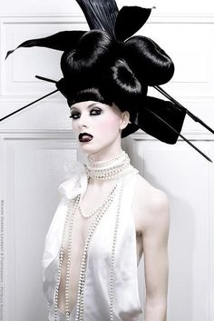 Avant Garde Hair To The Extreme Sleek And Good Use Of Hair Buns. #AvantGarde #SleekHair #HairBuns