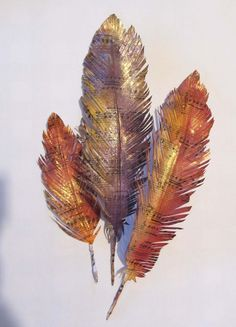 Paper feathers. We added colour to ours with Distress inks and sprays by Dylusions and perfect pearls