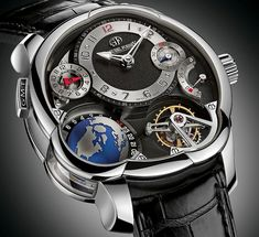 "Greubel Forsey GMT Watch Now In Platinum - by Patrick Kansa - Read more on aBlogtoWatch.com ""We've covered a number of Greubel Forsey watches here, and while they're all unique to one another, they share a common design DNA. Much of this can be seen in the various ways that complications are built and utilized in a watch. For many of the models, this uniqueness transmits itself all the way out to the case, which often has uncommon curves and bulges added..."""