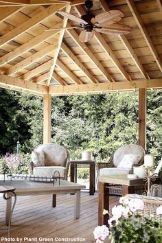 These homeowners love their wood, as they went with an all wood deck and exposed wood structure above. The leaf upholstery and wooden ceiling fan adds subtle touches.