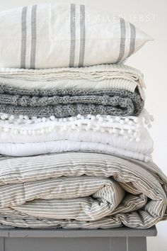 cozy linens. I love all the textures and patterns.. I want them all!