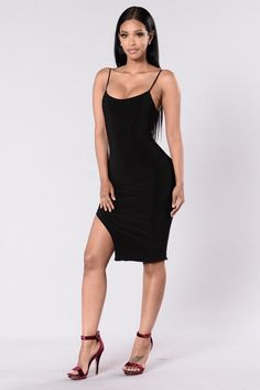 - Available in Black and Red Brown - Nylon Dress - Fitted - Knee Length - Side Slit - Spaghetti Straps - Lined - Made in USA - 96% Polyester 4% Spandex