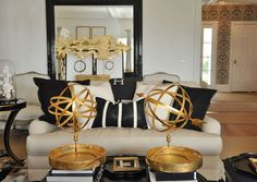 Black, white and gold! Note the zebra wallpaper in the background. Maybe for a very small space??