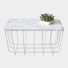 The marble top and powder-coated steel base on this Scamp Side Table ($180, originally $249) may have been modeled after tennis ball hoppers, but you don't need to be a sports fan to appreciate its architectural appeal (and hefty markdown!).