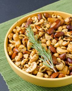 Here's an easy crowd pleasing snack you can make for your parties before your barbecue meats are ready. As the hot smoked nuts emerge from your pit, your guests are sure to drawn in by the buttery sweet fragrance of rosemary in your backyard. In my catering gigs, this is a very popular signature item. If you're not having a party, you can enjoy them while your barbecue cooks. Better yet if there's a football game going on and you're got your favorite ice-cold beer to keep you company.