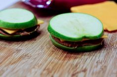 Applewiches make one of the simplest and quickest recipes for afternoon snacks for children. What am I saying, I still love an applewich made with a tart Granny Smith apple, real cheddar cheese and peanut butter. There's just nothing like it. Growing up, my Daddy would bring home a hoop of