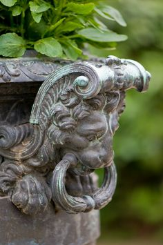 Urn planter with lion's head handle.