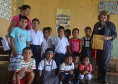 Diana Bowie with a group of children from one of the villages