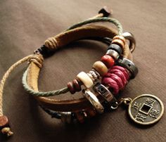 leather wrapped bracelet with beads, coins and layers of goodness