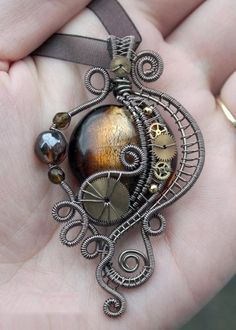 Victorian styled Steampunk pendant with polished glass, wire wrapping and watch parts. (I'm not really into Steampunk, but this is gorgeous) Moda Steampunk, Art Steampunk, Steampunk Wedding, Steampunk Fashion, Steampunk Necklace, Victorian Steampunk, Fashion Goth, Steampunk Cosplay, Steampunk Design