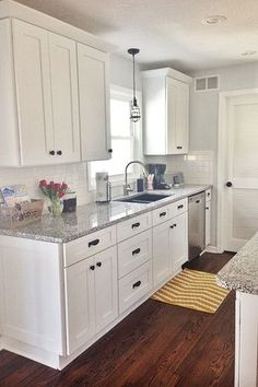 Traditional Kitchen with Subway Tile, Macroni caged pendant, Double bowl undermount granite composite sink, Shaker cabinet