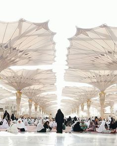 """Taken in Madina Saudi Arabia walking beneath the shades of these magnificent gigantic umbrellas they are beyond more beautiful the time they open and close. . The country has always been visited by a vast number of muslims from different continents and nations around the world specifically the two holy cities - Makkah and Madina. . """"I am Mohammed Aizhar Alih born and raised in Saudi Arabia. What the media shows doesn't always add up to what I see and live in real life. There is so much…"""