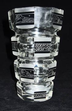 A rare vintage Czechoslovak Art Deco #glass vase by the Palda factory.  The vase is a heavy blown glass vase that has been cut to form an eight sided vessel.  The cut glass sides are of alternate polished and frosted facets with black enamel panels that have each received further engraving. This is a rare and intricate Deco design from the Palda factory. C late 1920s