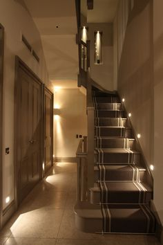 Well-designed marker lights will reduce staircase glare by being well recessed into the wall #staircase #lighting #staircaselighting #halleway #realhomes