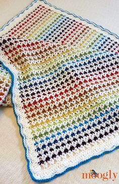 This is the Happiest Blanket Ever! Or at least the happiest blanket I've ever made. It was fun to make, and puts a smile on my face every time I look at it - I hope it does the same for you!