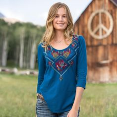 """IMOGEN TEE�--�Our exclusive super soft Johnny Was tee is embellished with vivid embroidery highlighting a feminine scooped neckline. Shirttail hem and three-quarter sleeves. Cotton. Machine wash. Imported. Sizes XS (2), S (4 to 6), M (8 to 10), L (12 to 14), XL (16). Approx. 27-1/4""""L."""