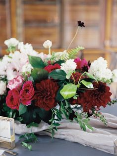 red dahlia centerpiece - photo by Ashley Kelemen http://ruffledblog.com/organic-sophistication-in-venice-beach