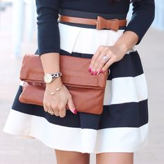 Black striped skirt and black top with brown bow belt and brown foldover purse. Great outfit for fall // http://www.stylishpetite.com/p/instagram-outfits.html