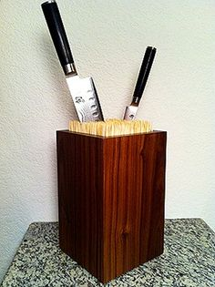 Hollow block filled with skewers as a knife-block......i could totally make that!