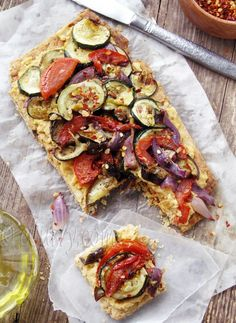 Grilled Vegetable and Hummus Tart. I often cheat and use pita or nan bread, grilled veggies, generous sprinkle of feta, kalamata olives and homemade garlicky basil pesto!
