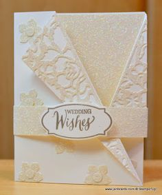 This is a Wedding Robe card I made using Stampin' Up! Dazzling Details Glimmer Paper and Detailed Floral Thinlits. Check out my video. https://youtu.be/fQH7Y_XyJZQ