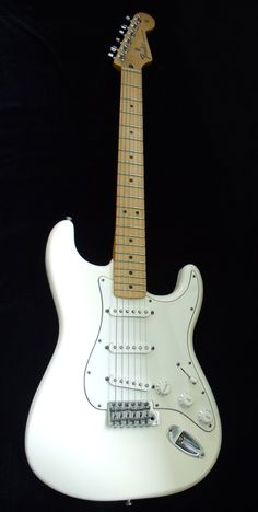 Fender Stratocaster - Arctic White. I've always been a fan of the white on white look. I went with this look when I got my 60's road-worn strat.